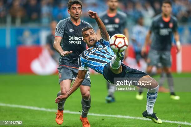 Alisson of Gremio battles for the ball against Matias Ruiz of Estudiantes during the match between Gremio and Estudiantes part of Copa Conmebol...