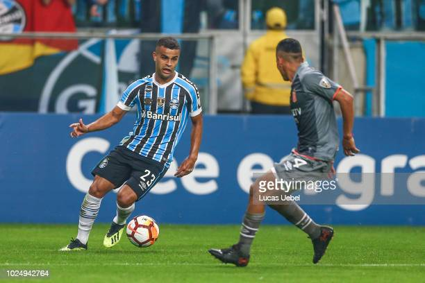 Alisson of Gremio battles for the ball against Sanchez of Estudiantes during the match between Gremio and Estudiantes part of Copa Conmebol...