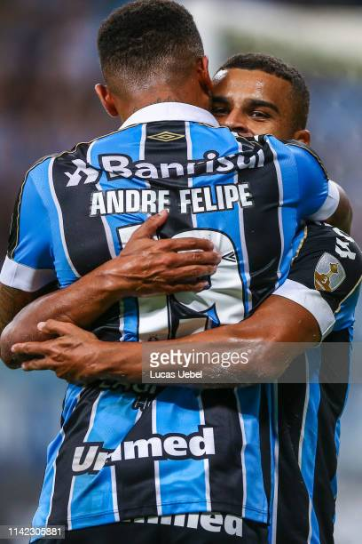 Alisson of Gremio celebrates after scoring the first goal of his team with teammate André Felipe during the match between Gremio and Universidad...