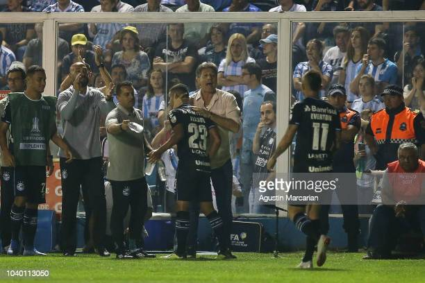 Alisson of Gremio celebrates with his coach Renato Gaucho after scoring the first goal of his team during a quarter final first leg match between...