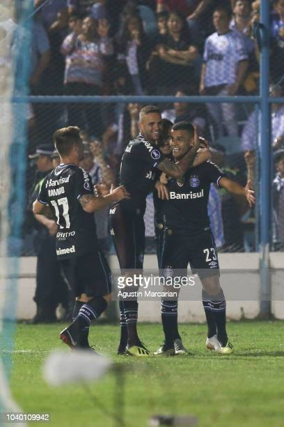 Alisson of Gremio celebrates with teammates after scoring the first goal of his team during a quarter final first leg match between Atletico Tucuman...