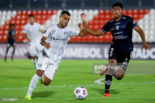 Alisson of Gremio fights for the ball with Luis Segovia of Independiente del Valle during a third round first leg match between Independiente del...