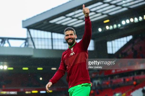 Alisson of Liverpool acknowledges the fans after the Premier League match between Liverpool and Crystal Palace at Anfield on May 23, 2021 in...