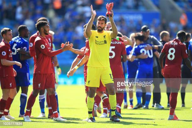 Alisson of Liverpool applauds fans after the Premier League match between Leicester City and Liverpool FC at The King Power Stadium on September 1...