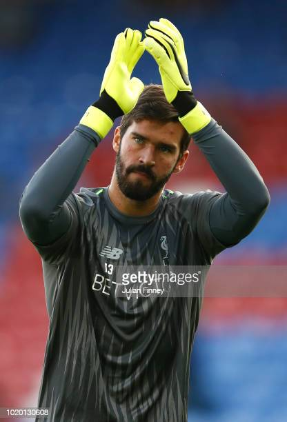Alisson of Liverpool applauds fans prior to the Premier League match between Crystal Palace and Liverpool FC at Selhurst Park on August 20 2018 in...