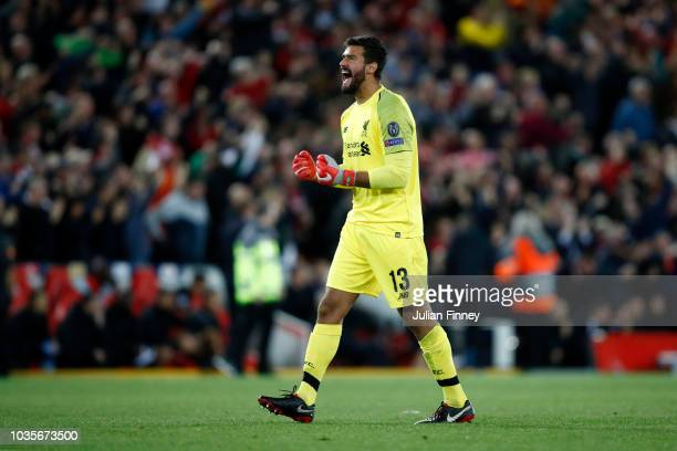 Alisson of Liverpool celebrates after his team's third goal during the Group C match of the UEFA Champions League between Liverpool and Paris...