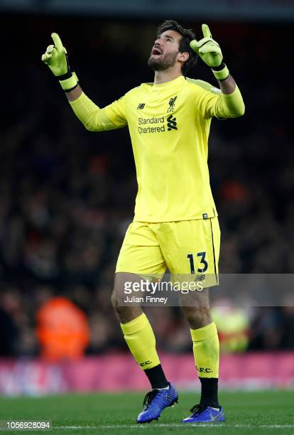 Alisson of Liverpool celebrates after James Milner of Liverpool scores his sides first goal during the Premier League match between Arsenal FC and...