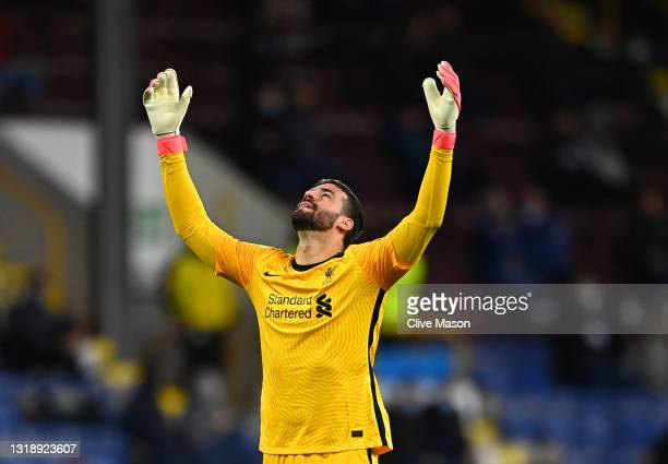 Alisson of Liverpool celebrates after their side's third goal scored by Alex Oxlade-Chamberlain during the Premier League match between Burnley and...