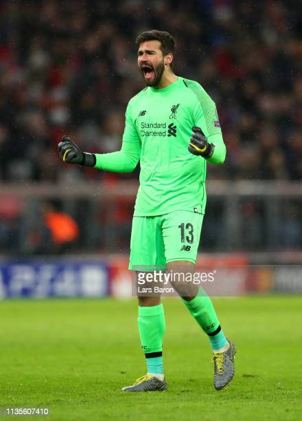 Alisson of Liverpool celebrates as Virgil van Dijk scores his team's second goal during the UEFA Champions League Round of 16 Second Leg match...