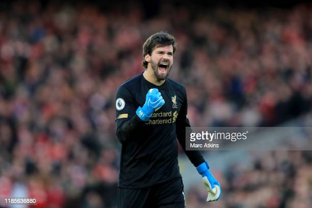 Alisson of Liverpool celebrates during the Premier League match between Liverpool FC and Brighton Hove Albion at Anfield on November 30 2019 in...