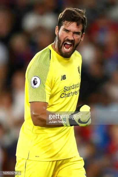 Alisson of Liverpool celebrates during the Premier League match between Crystal Palace and Liverpool FC at Selhurst Park on August 20 2018 in London...