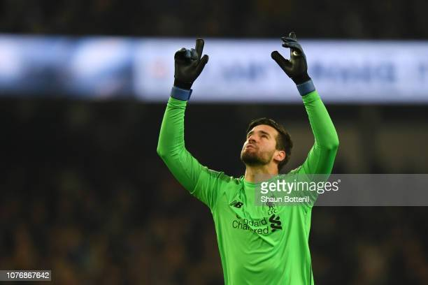 Alisson of Liverpool celebrates his sides first goal during the Premier League match between Manchester City and Liverpool FC at the Etihad Stadium...