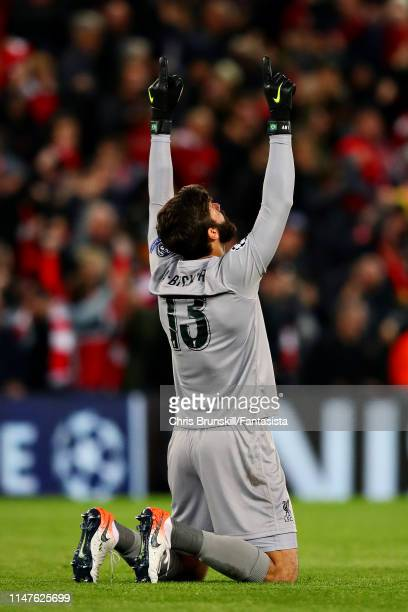 Alisson of Liverpool celebrates his sides third goal during the UEFA Champions League Semi Final second leg match between Liverpool and Barcelona at...