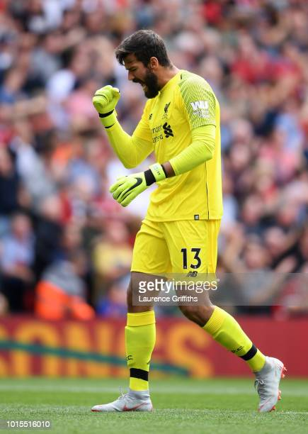 Alisson of Liverpool celebrates his team's first goal during the Premier League match between Liverpool FC and West Ham United at Anfield on August...