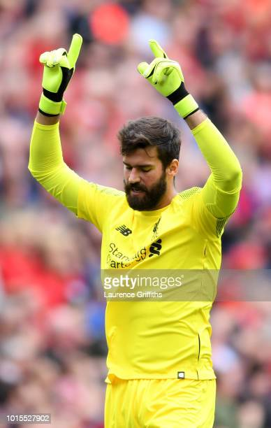 Alisson of Liverpool celebrates his team's second goal scored by Sadio Mane during the Premier League match between Liverpool FC and West Ham United...