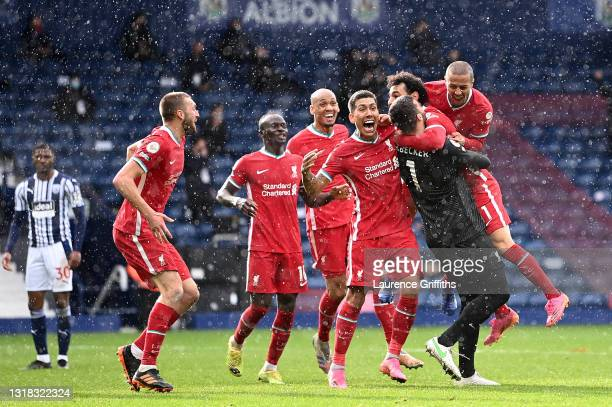 Alisson of Liverpool celebrates with team mates Sadio Mane, Fabinho, Roberto Firmino, Mohamed Salah and Thiago after scoring their side's second goal...