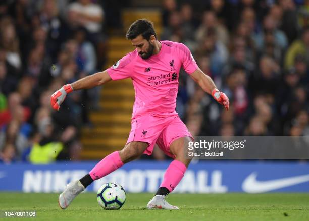 Alisson of Liverpool clears the ball during the Premier League match between Chelsea FC and Liverpool FC at Stamford Bridge on September 29 2018 in...