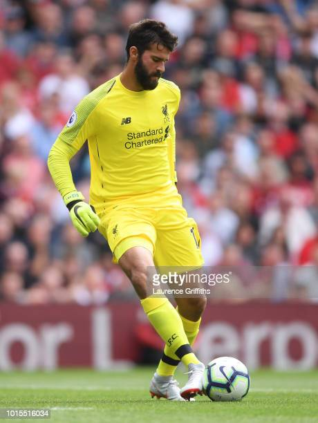 Alisson of Liverpool controls the ball during the Premier League match between Liverpool FC and West Ham United at Anfield on August 12 2018 in...