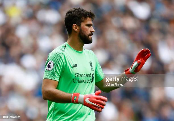 Alisson of Liverpool gives his team instructions during the Premier League match between Tottenham Hotspur and Liverpool FC at Wembley Stadium on...