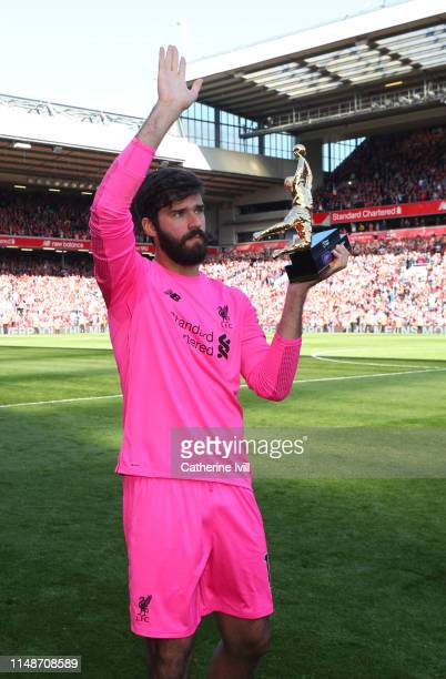 Alisson of Liverpool holds the golden boot award after the Premier League match between Liverpool FC and Wolverhampton Wanderers at Anfield on May 12...