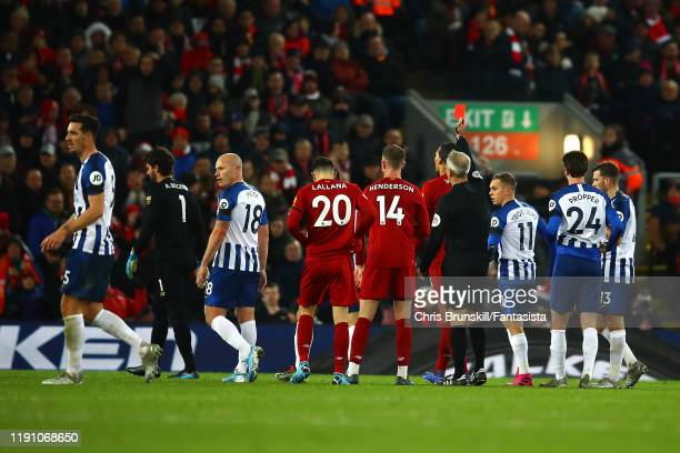 Alisson of Liverpool is sent off by referee Martin Atkinson during the Premier League match between Liverpool FC and Brighton & Hove Albion at...