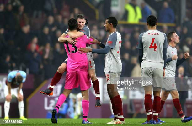 Alisson of Liverpool James Milner of Liverpool and Joel Matip of Liverpool celebrate following their sides victory in the Premier League match...
