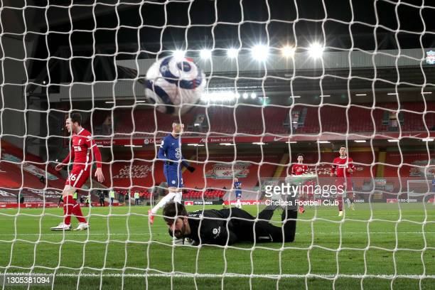 Alisson of Liverpool looks on at the ball after conceding Chelsea's first goal scored by Mason Mount of Chelsea during the Premier League match...