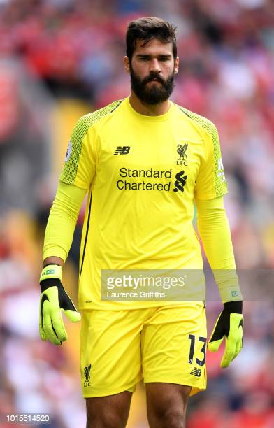 Alisson of Liverpool looks on during the Premier League match between Liverpool FC and West Ham United at Anfield on August 12 2018 in Liverpool...