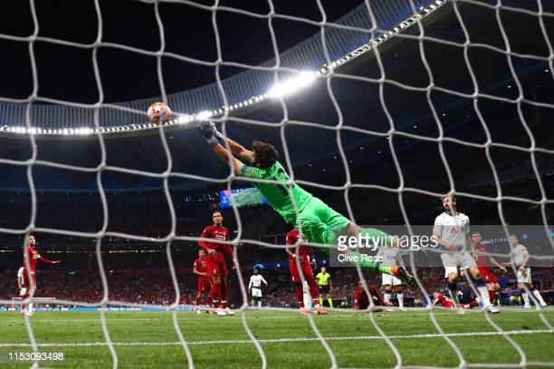 Alisson of Liverpool makes a save during the UEFA Champions League Final between Tottenham Hotspur and Liverpool at Estadio Wanda Metropolitano on...