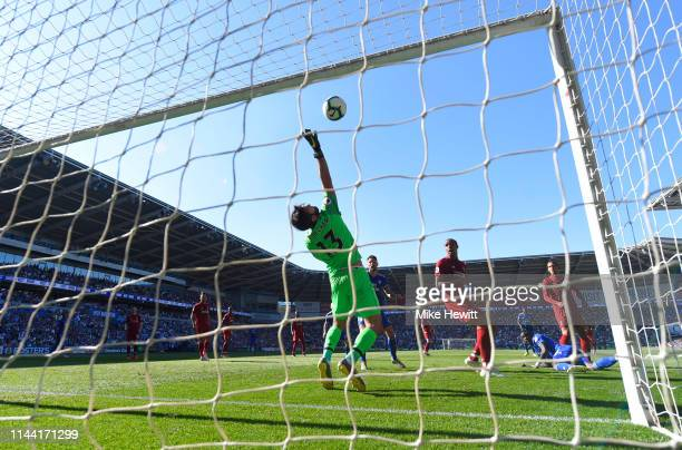 Alisson of Liverpool makes a save Oumar Niasse of Cardiff City during the Premier League match between Cardiff City and Liverpool FC at Cardiff City...