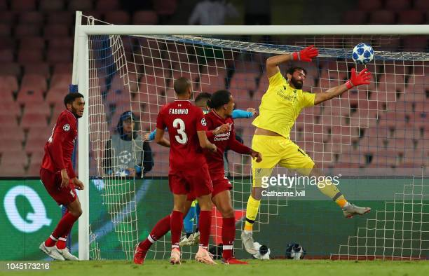 Alisson of Liverpool reaches for the ball during the Group C match of the UEFA Champions League between SSC Napoli and Liverpool at Stadio San Paolo...