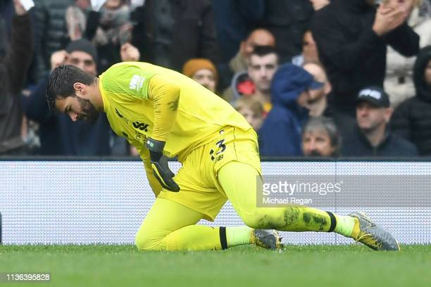 Alisson of Liverpool reacts after Ryan Babel of Fulham scores his sides first goal during the Premier League match between Fulham FC and Liverpool FC...