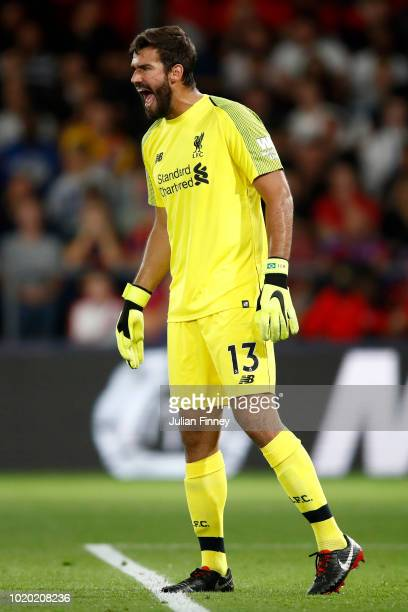 Alisson of Liverpool reacts during the Premier League match between Crystal Palace and Liverpool FC at Selhurst Park on August 20 2018 in London...
