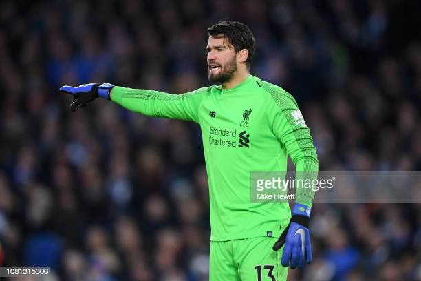 Alisson of Liverpool reacts during the Premier League match between Brighton Hove Albion and Liverpool FC at American Express Community Stadium on...