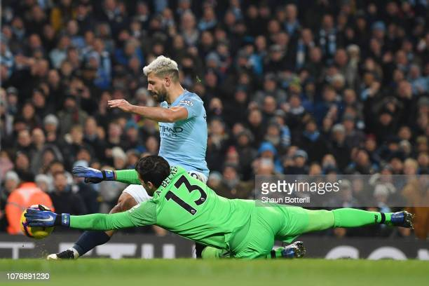 Alisson of Liverpool saves from Sergio Aguero of Manchester City during the Premier League match between Manchester City and Liverpool FC at the...