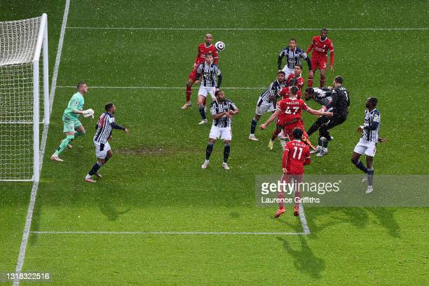 Alisson of Liverpool scores their side's second goal past Sam Johnstone of West Bromwich Albion during the Premier League match between West Bromwich...