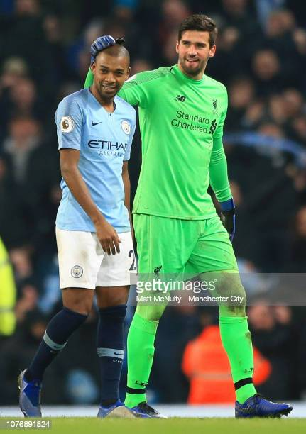 Alisson of Liverpool speaks to Fernandinho of Manchester City after the Premier League match between Manchester City and Liverpool FC at the Etihad...