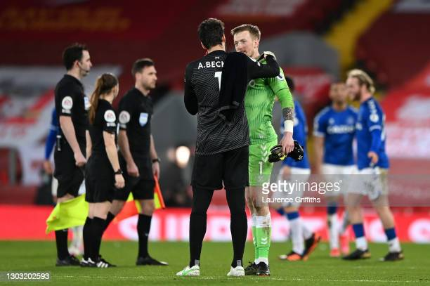Alisson of Liverpool speaks with Jordan Pickford of Everton following the Premier League match between Liverpool and Everton at Anfield on February...