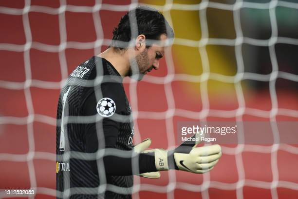 Alisson of Liverpool takes a moment of reflection following the UEFA Champions League Quarter Final Second Leg match between Liverpool FC and Real...