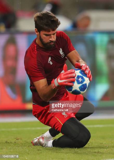 Alisson of Liverpool warms up prior to the Group C match of the UEFA Champions League between SSC Napoli and Liverpool at Stadio San Paolo on October...