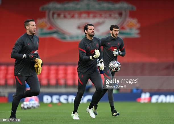 Alisson of Liverpool warms up with team mates prior to the UEFA Champions League Quarter Final Second Leg match between Liverpool FC and Real Madrid...