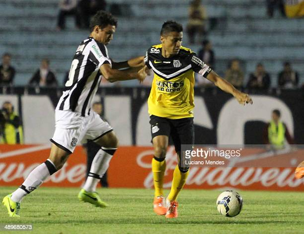 Alisson of Santos babe Nem of Figueirense in game in Series A Brasileirao 2014 at Cafe Stadium on May 11 2014 in Londrina Brazil