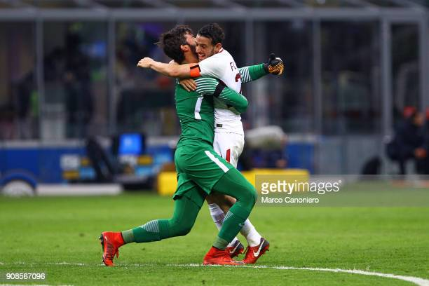 Alisson Ramses Becker of As Roma celebrate with his teammate Alessandro Florenzi during the Serie A football match between Fc Internazionale and As...