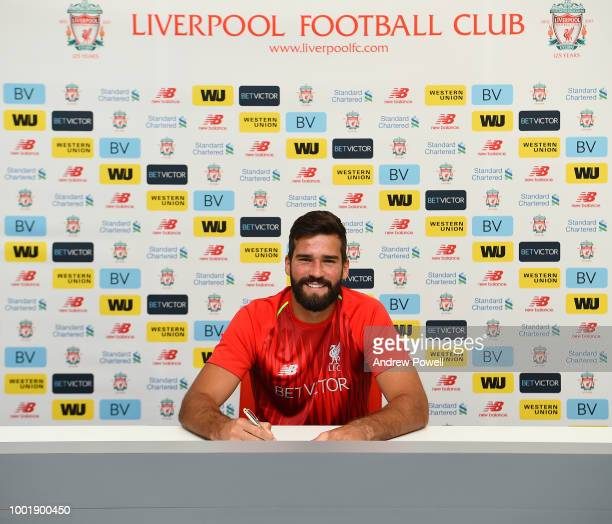 Alisson signing a new contract for Liverpool FC at Melwood Training Ground on July 19 2018 in Liverpool England