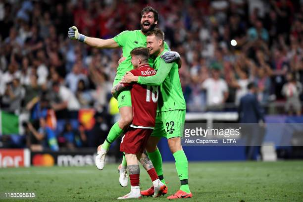 Alisson Simon Mignolet and Alberto Moreno of Liverpool celebrate victory at fulltime after the UEFA Champions League Final between Tottenham Hotspur...