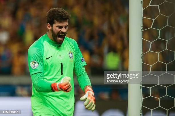 Alisson the Brazil celebrates after scoring Gabriel Jesus during of the Conmebol America Cup Brazil 2019 match between Brazil and Argentina at...