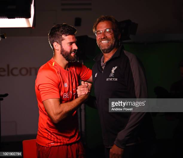 Alisson with Jurgen Klopp manager of Liverpool after signing a new contract for Liverpool FC at Melwood Training Ground on July 19 2018 in Liverpool...