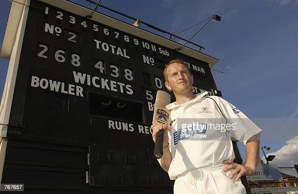Alistair Brown of Surrey poses in front of the scoreboard after he scores a world record 268 runs in a team record of 438 in a 50 over match during...