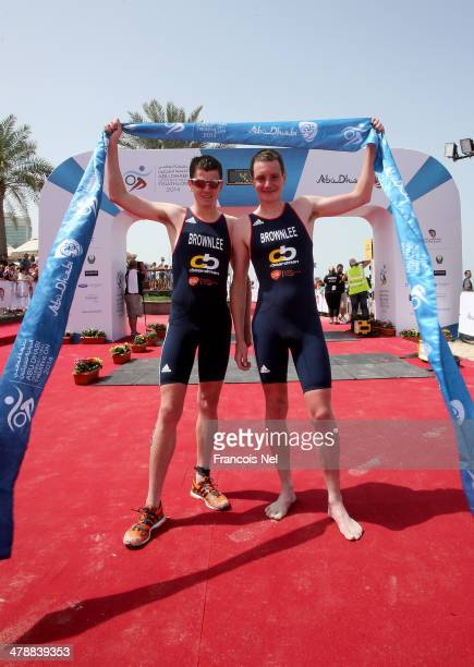 Alistair Brownlee and Jonathan Brownlee of Great Britain celebrate after winning the Short Course Men's Elite race duing the Abu Dhabi International...