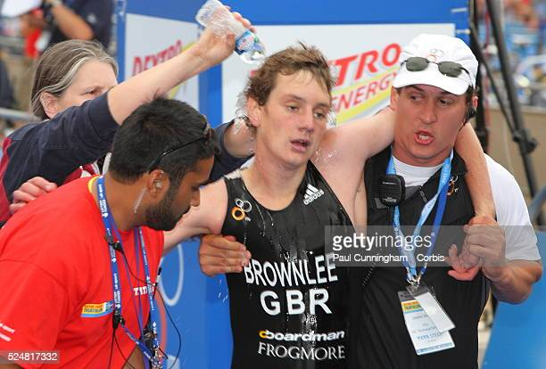 Alistair Brownlee GBR finishes exhausted on the line in 10th place of the Dextro Energy Triathlon ITU World Championship Elite Men's race Hyde Park...